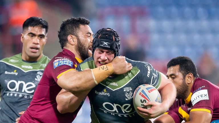 Chris Hill is tackled by Huddersfield's Suai Matagi during the contest