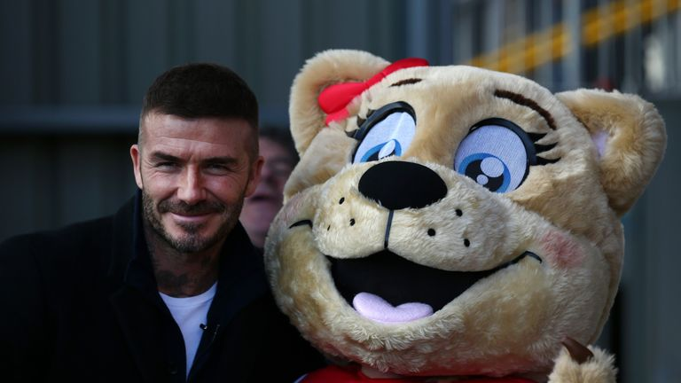 David Beckham meets the Salford mascot ahead of kick-off