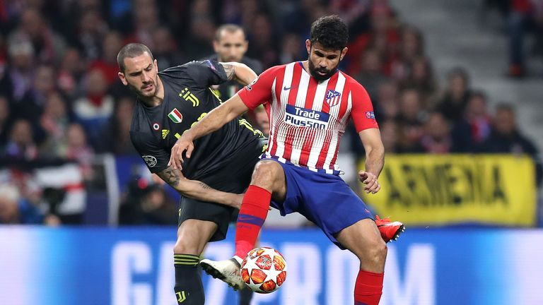 Atletico striker Diego Costa is challenged by Juventus' Leonardo Bonucci