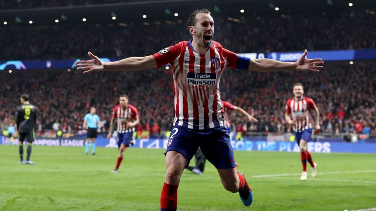 Diego Godin celebrates after doubling Atletico's lead