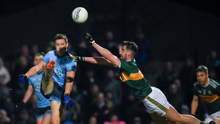 Dean Rock of Dublin is blocked by Jason Foley of Kerry