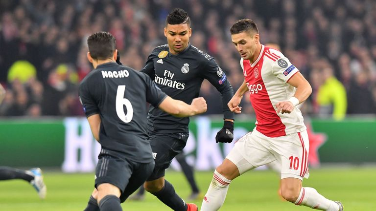 Ajax forward Dusan Tadic (R) fights for the ball