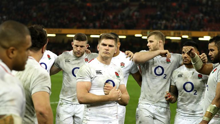 England's players look on in dejection after coming up short in Wales