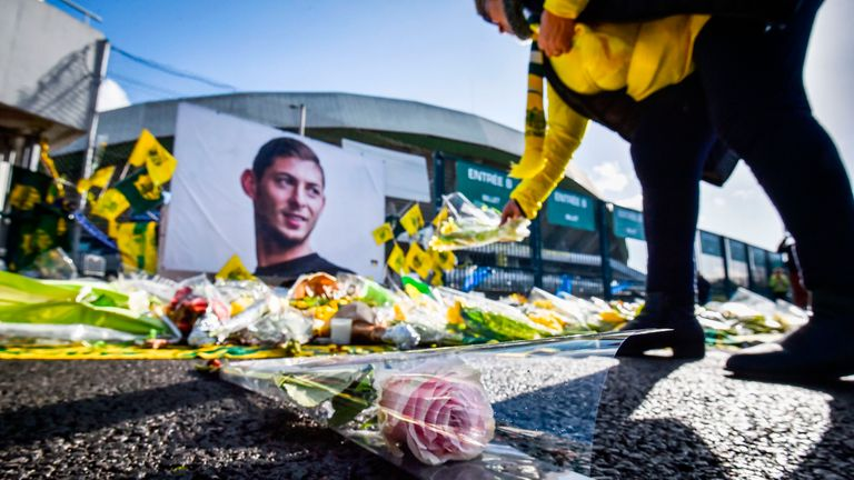 A FC Nantes supporter lays flowers in tribute to Emiliano Sala outside the club's La Beaujoire stadium