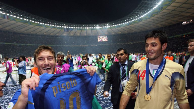 Amelia celebrating Italy's 2006 World Cup win with Francesco Totti