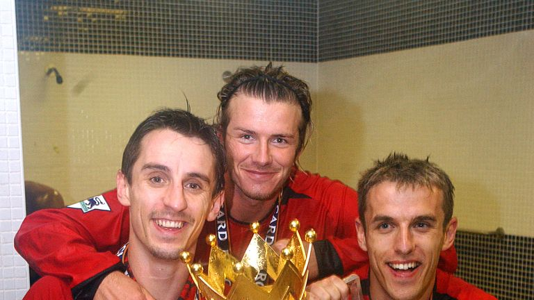 Gary Neville, David Beckham and Phil Neville celebrate