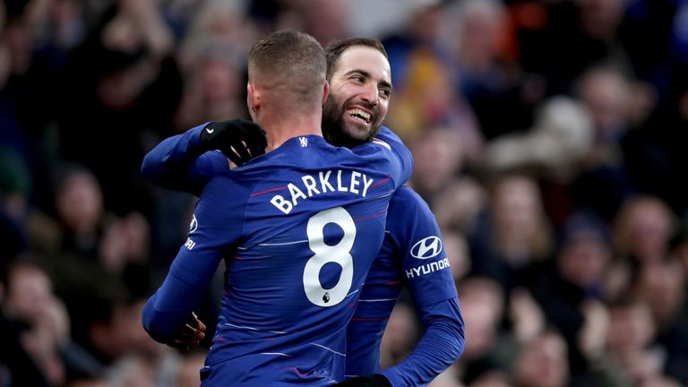 Higuain celebrates his second goal with Ross Barkley