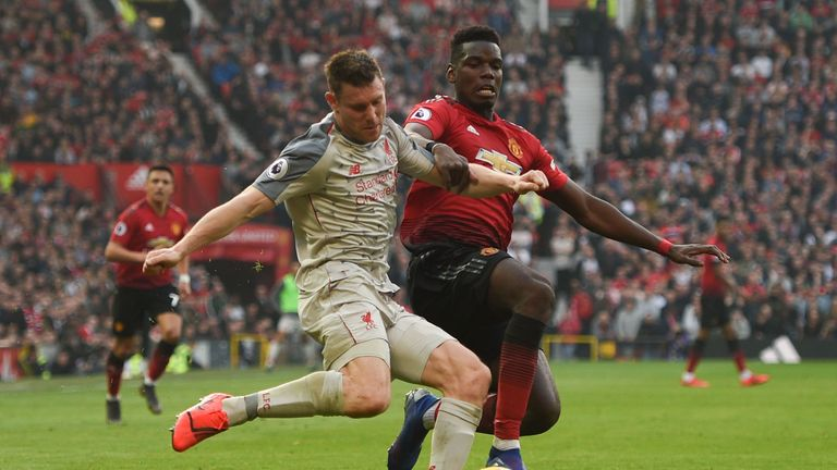 James Milner is challenged by Paul Pogba