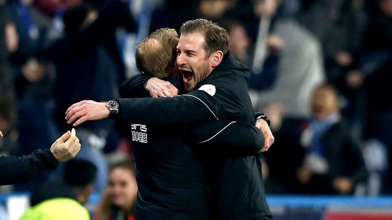 Jan Siewert celebrates Steve Mounie's injury-time winner at home to Wolves