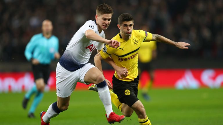 Juan Foyth of Tottenham Hotspur is challenged by Christian Pulisic of Borussia Dortmund