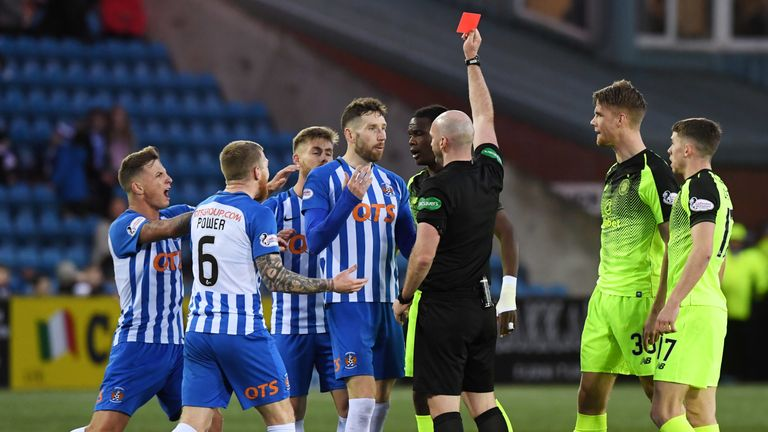 Referee Bobby Madden shows Kilmarnock's Kirk Broadfoot a red card