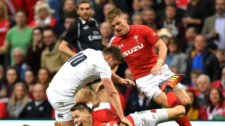 Wales' Liam Williams secures a loose ball under pressure from England's Owen Farrell