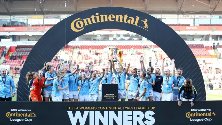 Manchester City celebrate with the trophy