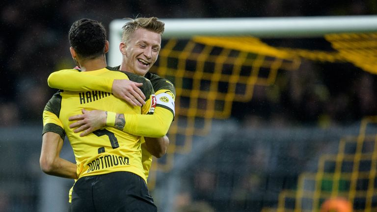 Marco Reus celebrates scoring for Dortmund