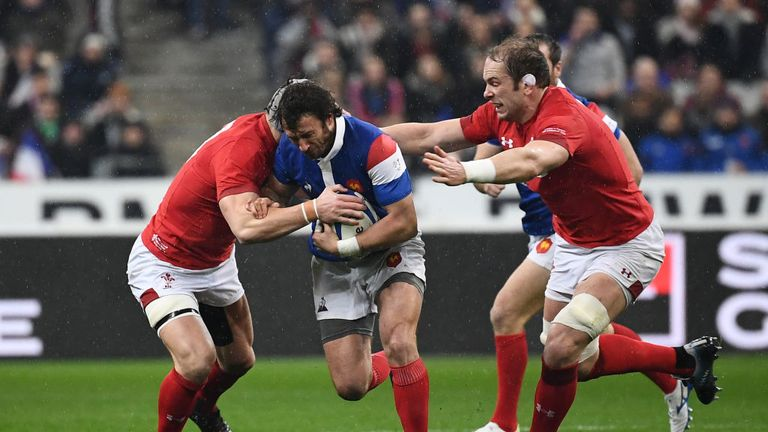 Maxime Medard is tackled by Wales defenders