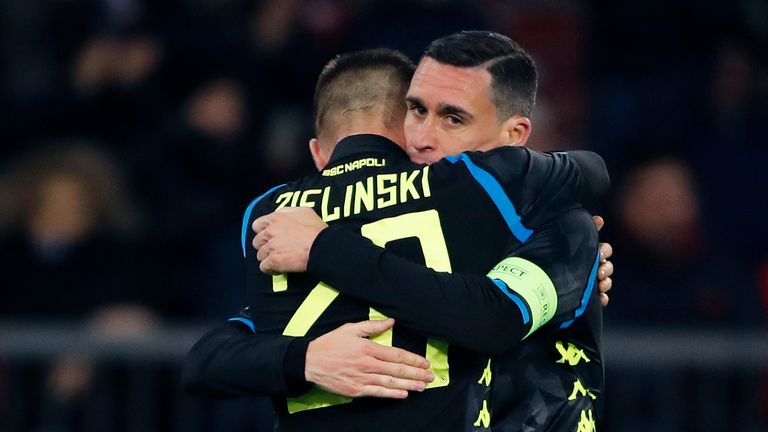 Piotr Zielinski celebrates with Jose Callejon after scoring Napoli's third goal