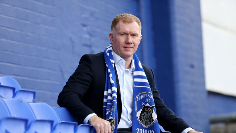 Paul Scholes signed an 18-month contract as Oldham boss on Monday