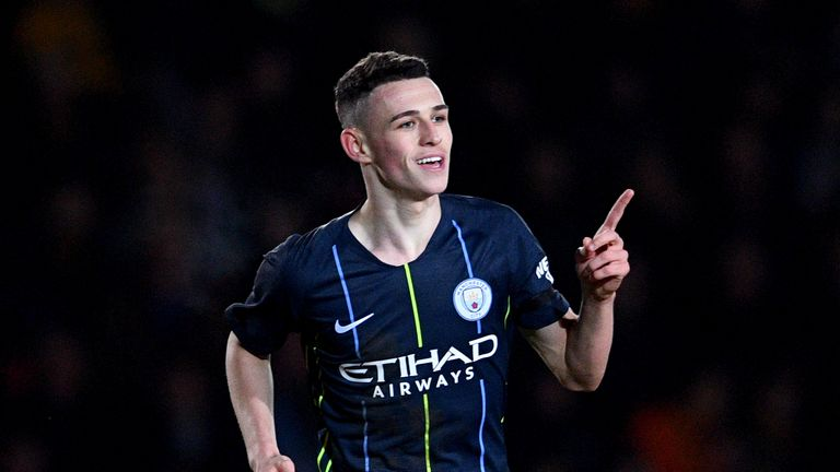 Phil Foden celebrates his second goal against Newport County