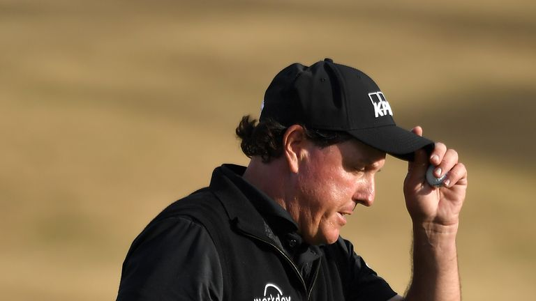 Defending champion Phil Mickelson slumped to a 79