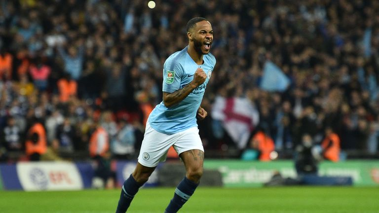 Raheem Sterling celebrates scoring the winning penalty