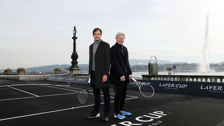Federer  and Team Europe skipper Bjorn Borg pose on the black court in Geneva