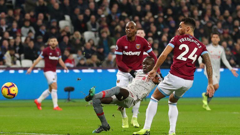 Sadio Mane slides Liverpool in front after receiving James Milner's cross
