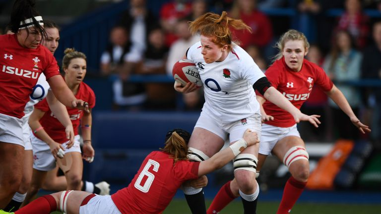 Sarah Beckett of England is tackled by Bethan Lewis of Wales
