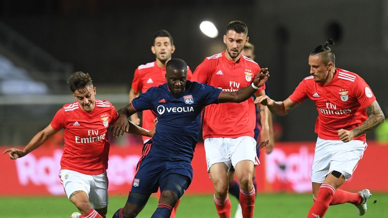 Ndombele shields the ball against Benfica