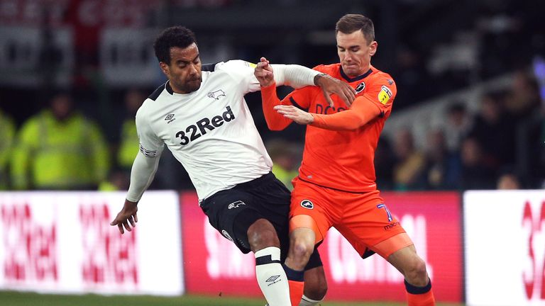 Derby County's Tom Huddlestone (left) and Millwall's Jed Wallace battle for the ball