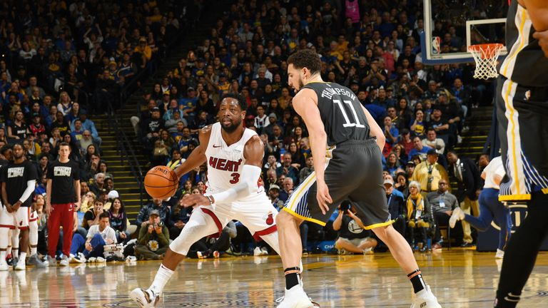 Dwyane Wade of the Miami Heat handles the ball during the game against Klay Thompson of the Golden State Warriors