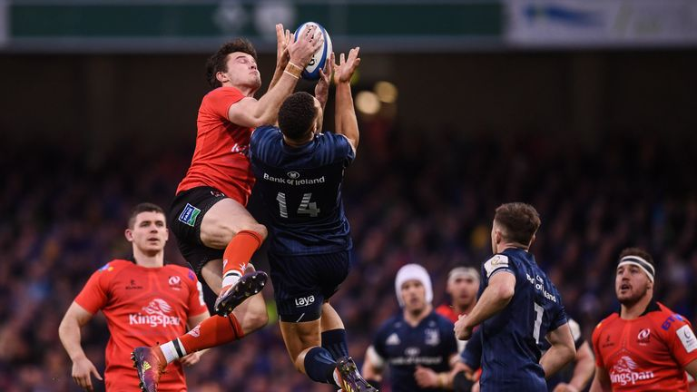 Byrne and Jacob Stockdale of Ulster compete for the ball
