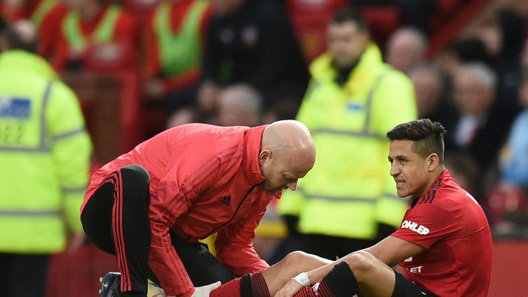 Alexis Sanchez receives medical attention after picking up an injury during the Premier League match against Southampton
