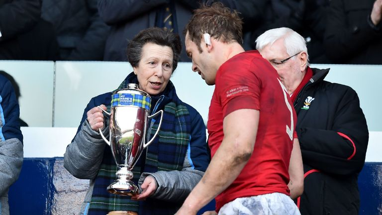 Wales' captain Alun Wyn Jones receives the winner's trophy from Princess Anne