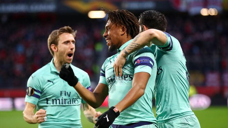Alex Iwobi celebrates with Arsenal team-mate Granit Xhaka and Nacho Monreal after scoring