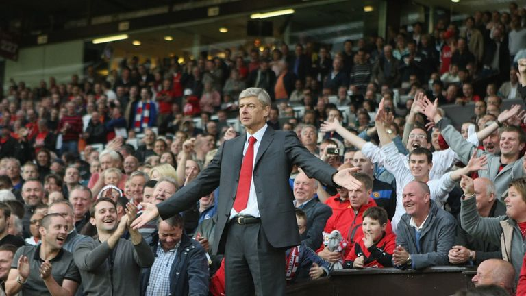 Arsene Wenger protests from the stands at Old Trafford