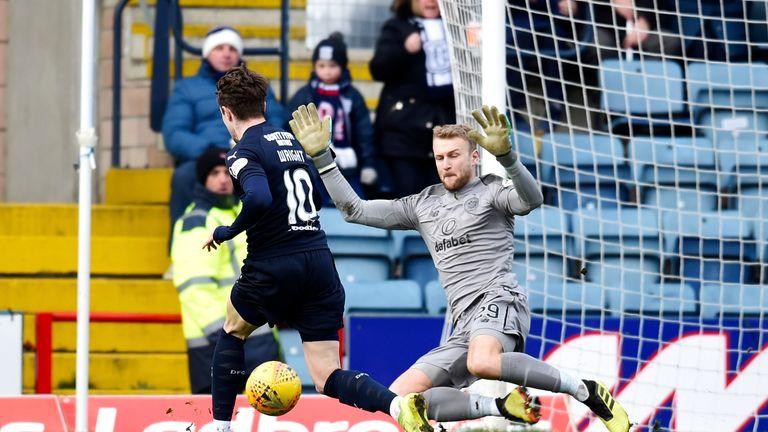 Dundee's Scott Wright sees his effort saved by Celtic goalkeeper Scott Bain