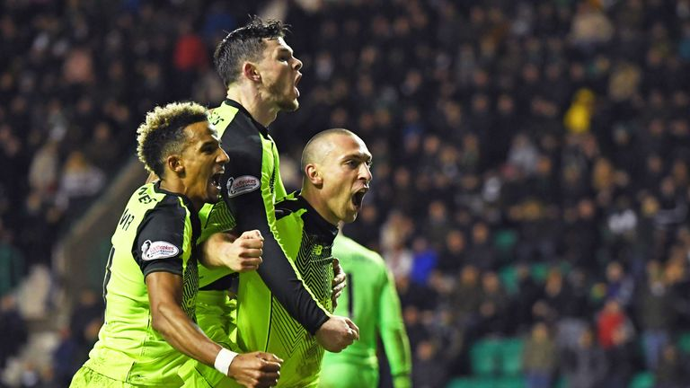 Scott Brown celebrates his goal with Oli Burke and Scott Sinclair