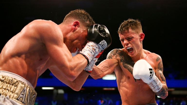 Charlie Edwards attacks Angel Moreno during his WBC flyweight title defence