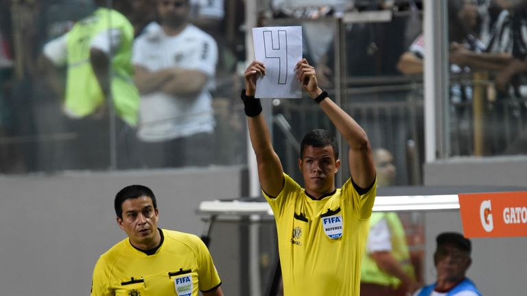 Officials used hand-made signs in the absence of an electronic board