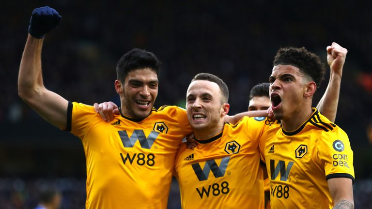 Diogo Jota celebrates after scoring the opening goal of the game for Wolves against Cardiff