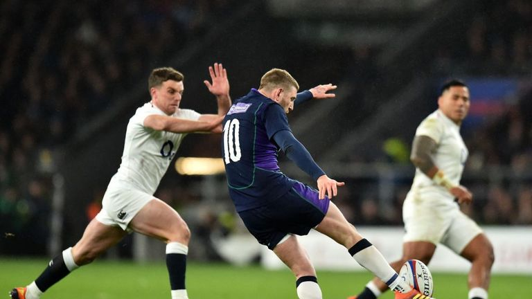 Finn Russell putting boot to ball in the second-half against England