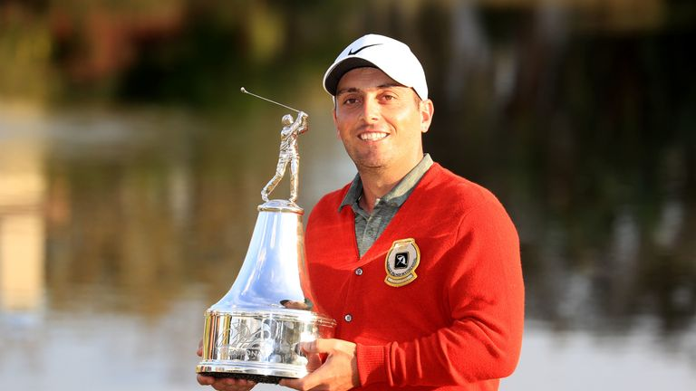 Francesco Molinari with the trophy after winning the Arnold Palmer Invitational