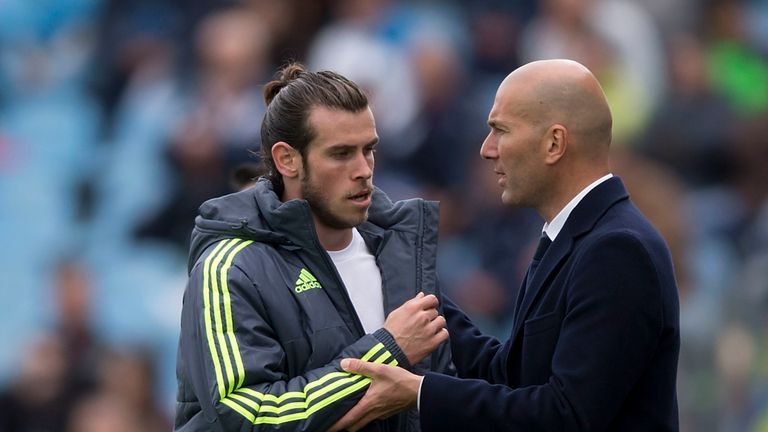 Real Madrid boss Zinedine Zidane (r) claimed forward Gareth Bale (l) was close to leaving the club over the weekend