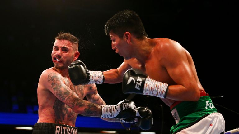 German Benitez lands a right on Lewis Ritson during their super lightweight clash