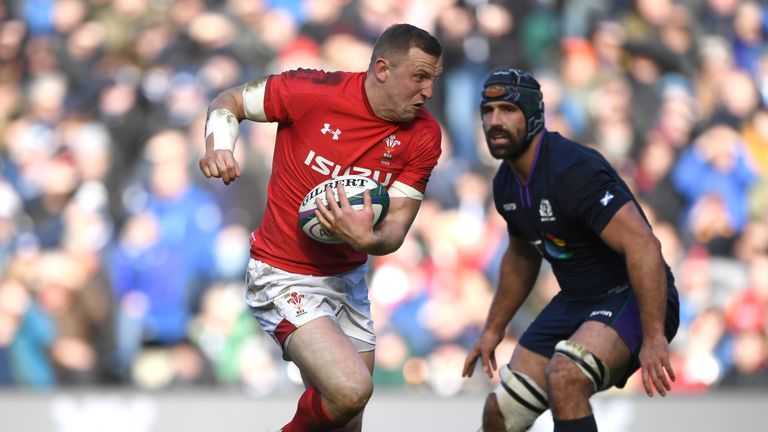 Hadleigh Parkes carries the ball in Wales' victory over Scotland