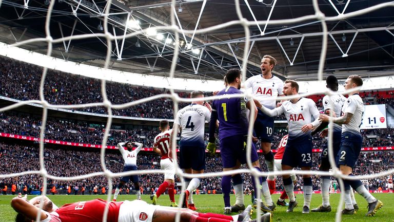 Hugo Lloris celebrates with team-mates after saving a late penalty while a dejected Pierre-Emerick Aubameyang lies nearby