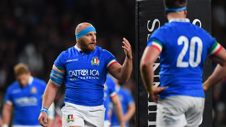 Italy's Leonardo Ghiraldini calls his players over after England's seventh try