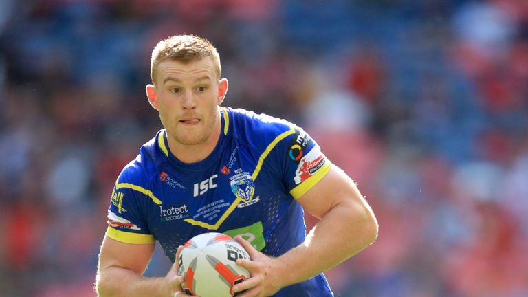Jack Hughes in action for Warrington Wolves in the 2018 Challenge Cup final