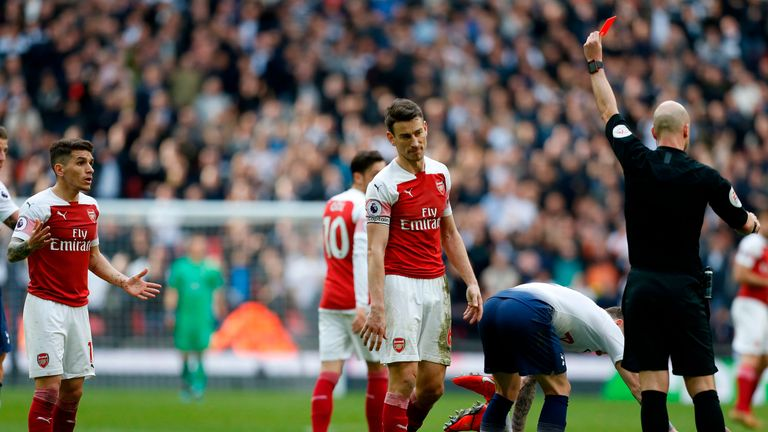 Torreira is sent off by referee Anthony Taylor after his challenge on Danny Rose