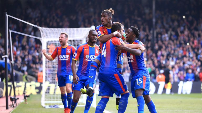 Luka Milivojevic is mobbed by team-mates after giving Crystal Palace the lead